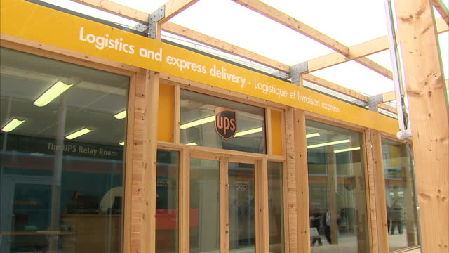interior shots of ups office ups branded boxes at the olympic site in stratford sky news 2012 olympics coverage at olympic village stratford on june... - ロンドン ストラトフォード点の映像素材/bロール