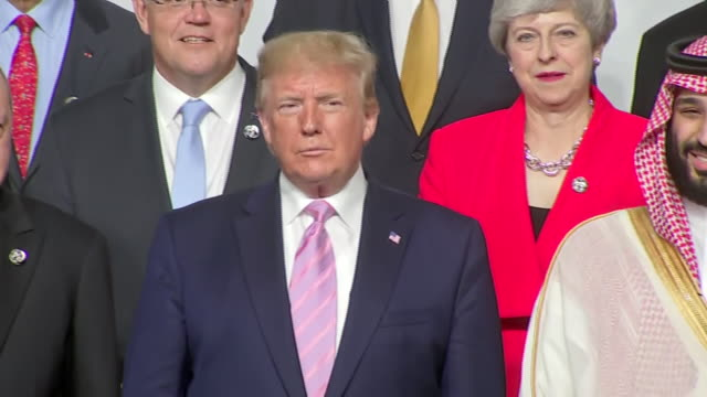 interior shots of us president donald trump at the g20 summit then stood next to a smiling saudi crown prince mohammed bin salman with british prime... - theresa may stock videos & royalty-free footage