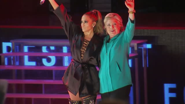 interior shots of us presidential candidate hillary clinton walking onto the stage greeted by jennifer lopez and marc anthony 2016 in new york united... - representing stock videos and b-roll footage