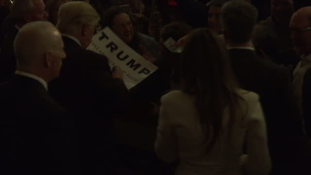 interior shots of us presidential hopeful donald trump and wife melania trump meeting supporters at a campaign rally in iowa nb audio is mute to... - iowa stock videos & royalty-free footage