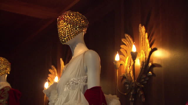 interior shots of various alexander mcqueen couture outfits on display at the 'savage beauty' exhibition at the victoria and albert museum>> on march... - victoria and albert museum london stock videos & royalty-free footage