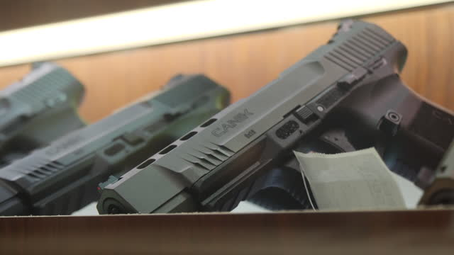 interior shots of various handguns on sale in display cabinets in a gun shop on 2 november 2020 in detroit, michigan, united states - gun stock videos & royalty-free footage