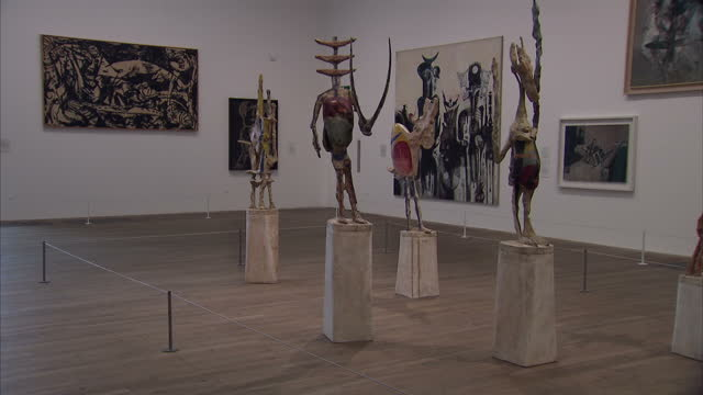 vídeos de stock, filmes e b-roll de interior shots of various sculptures and artworks on display inside a new building at the tate modern on june 14, 2016 in london, england. - museu