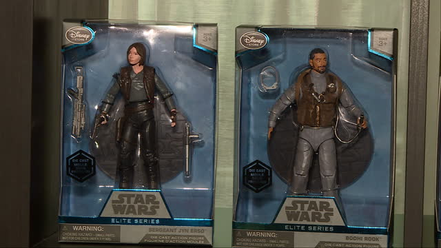 Interior shots of various Star Wars Rogue One merchandise on shelves including figurines of various characters lego kits and a Darth Vader toy at...