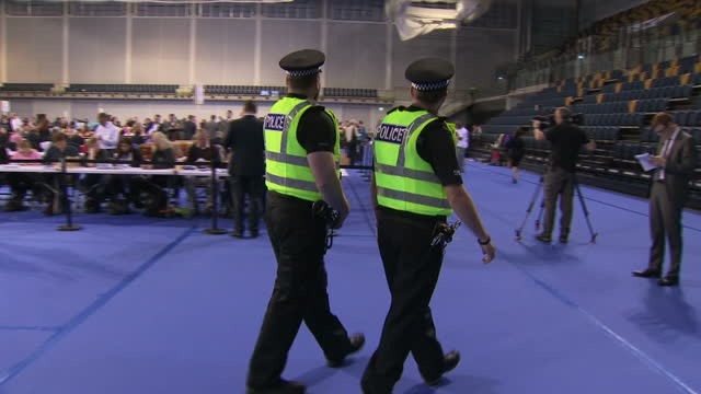 interior shots of vote counting underway at the glasgow emirates arena including shots of election staff carrying in ballot boxes and two police... - ballot box stock videos & royalty-free footage