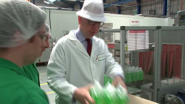 Interior shots of Vote Leave Campaigners Boris Johnson Michael Gove packing up soap bottles for distribution on their visit to the DCS Group Factory...