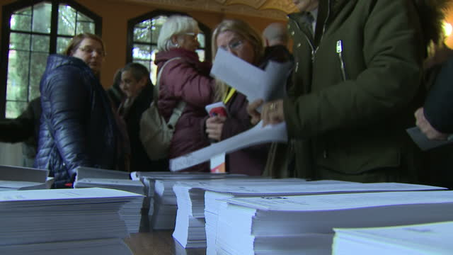 Interior shots of voters at a polling station collecting ballot papers and casting their votes in the Catalonian regional election on December 21...