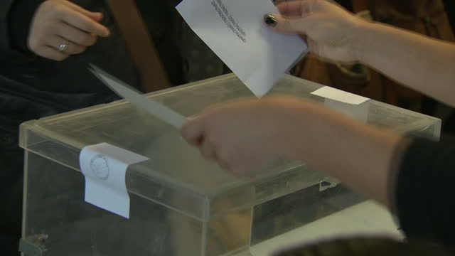 Interior shots of voters casting their ballots in a polling station during the Catalonian regional election on December 21 2017 in Barcelona Spain