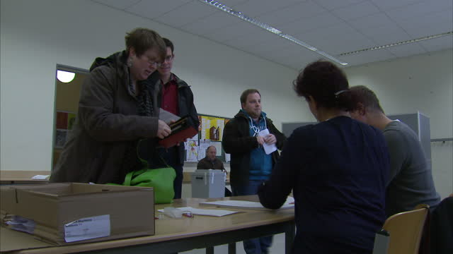 interior shots of voters casting their ballots in the german regional elections on march 16 2016 in magdeburg germany - wahlurne stock-videos und b-roll-filmmaterial