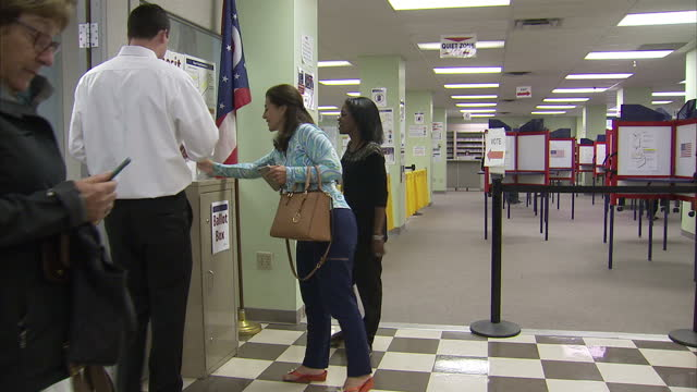 interior shots of voters in an ohio polling station casting votes during early voting in the 2016 presidential elections on october 19 2016 in oxford... - wahllokal stock-videos und b-roll-filmmaterial