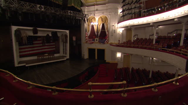 Interior shots of Washington DC's historic Ford's Theatre decked out with Stars and Stripes flags including a framed picture of George Washington and...