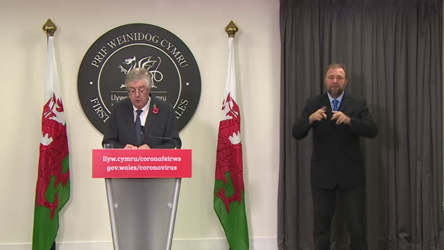 interior shots of welsh first minister mark drakeford unveiling new national measures to slow the spread of covid-19 at press conference on 2... - small town stock videos & royalty-free footage