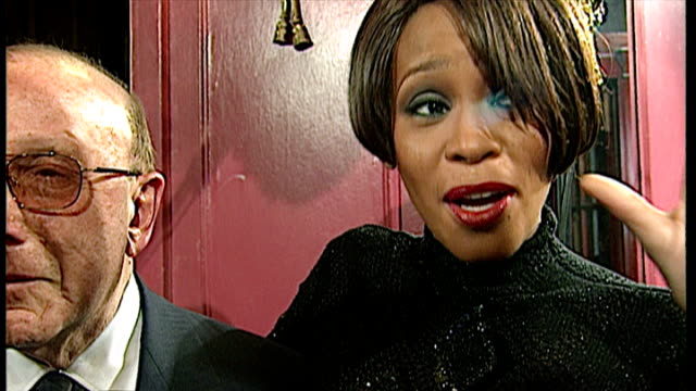 interior shots of whitney houston being interviews and she speaks about her music career and how its changing with new music clive davies also speaks... - whitney houston stock-videos und b-roll-filmmaterial