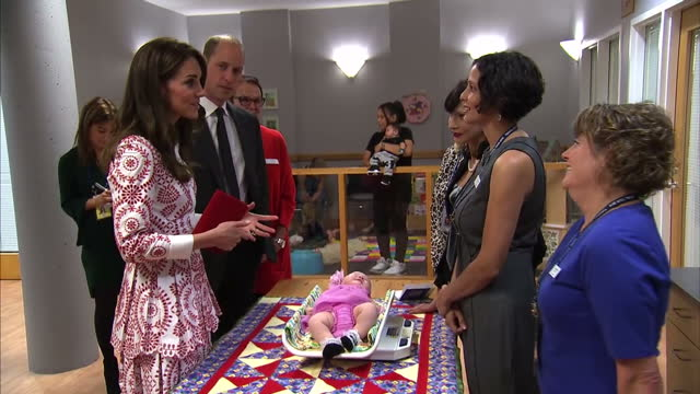 interior shots of william and kate visiting a pregnancy outreach programme called sheway meeting mothers and young babies and children on september... - will.i.am stock videos & royalty-free footage