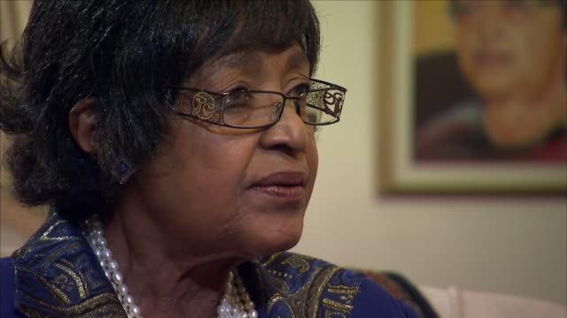 interior shots of winnie mandela in her home speaking to sky news correspondent alex crawford about nelson mandela and his health, being in current... - ハウテング州点の映像素材/bロール
