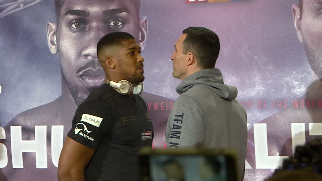 Interior shots of Wladimir Klitschko and Anthony Joshua facing off and posing for photographs following a news conference at Sky Central ahead of...