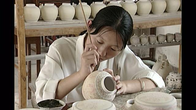 Interior shots of women decorating pots in porcerlain workshop on May 08 1998 in Jingdezhen Jiangxi province China