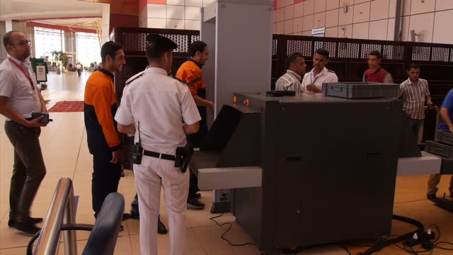 interior shots of workers in sharm el sheikh airport undergoing security screening and having belongings checked on november 06 2015 in sharm ash... - kogalymavia flug 9268 stock-videos und b-roll-filmmaterial