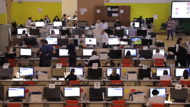 interior shots of workers working in a call centre on 20 march 2020 in moscow, russia. - place of work stock videos & royalty-free footage