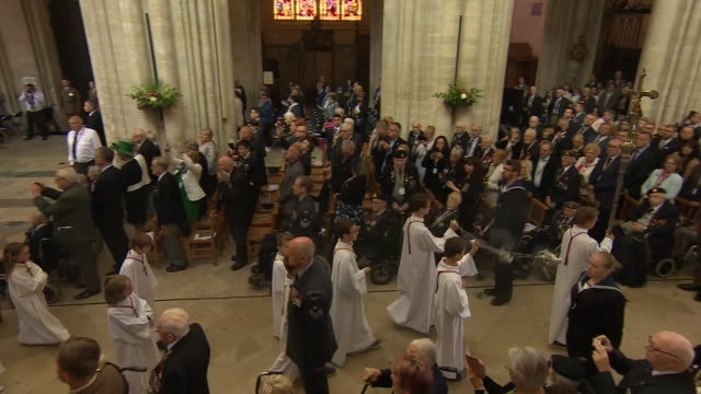 interior shots of world leaders and veterans leaving the remembrance service at the cathedral of bayeux commemorating 75th anniversary of the dday... - 礼拝点の映像素材/bロール