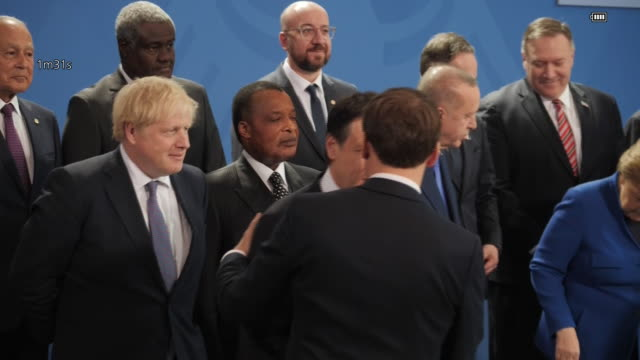 interior shots of world leaders posing for a family photo during a peace summit on libya at the chancellery in berlin britain's prime minister boris... - meeting stock videos & royalty-free footage