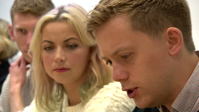 interior shots of writer and political activist owen jones speaking during an anti-austerity press conference with charlotte church listening.>> on... - charlotte church stock videos & royalty-free footage