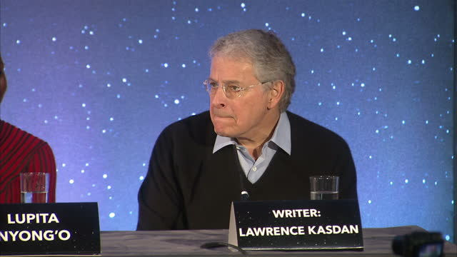 interior shots of writer lawrence kasdan answering question at a press conference for star wars: the force awakens about how he feels now the film... - an answer film title stock videos & royalty-free footage