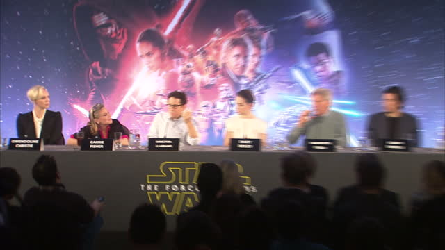 interior shots of writer lawrence kasdan director jj abrams answering question at a press conference for star wars the force awakens about how they... - an answer film title stock videos & royalty-free footage