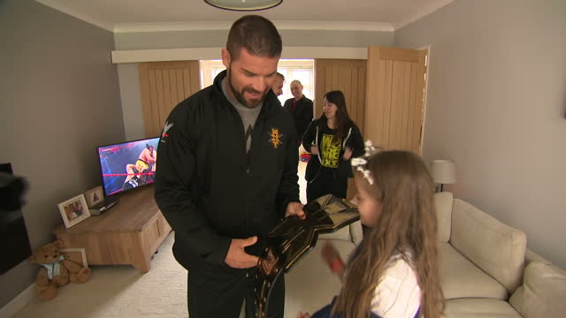 interior shots of wwe nxt wrestling champion bobby roode and costars mark andrews and nikki cross presenting lily harrison who was injured in the... - belt stock videos & royalty-free footage