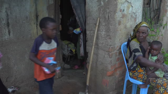 Interior shots of young boys sleeping on matresses waking up putting on shoes washing faces walking to a cobalt mining area on February 9 2017 in The...