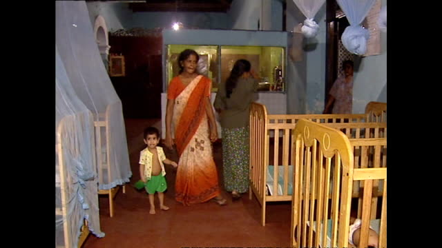 interior shots of young children and carers at an orphanage in galle please note it is not clear if these children have been directly affected or... - orphanage stock videos and b-roll footage