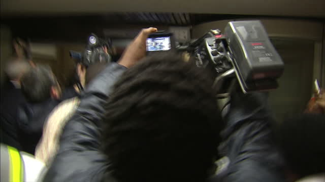 interior shots oscar pistorius departing court house after first day of trial for the murder of reeva steenkamp on march 03 2014 in pretoria south... - オスカー・ピストリウス点の映像素材/bロール
