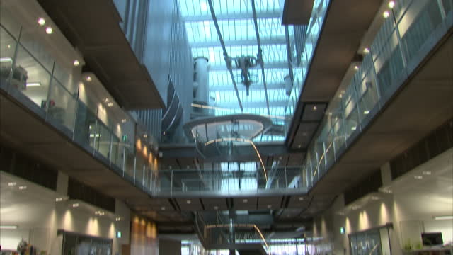 interior shots panning up and down the central atrium of the francis crick institute a view through the glass door of a laboratory towards an... - francis crick stock videos & royalty-free footage