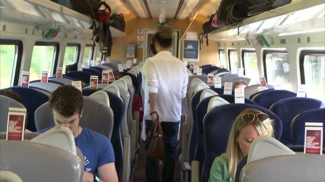 interior shots passengers inside train carriage on august 28 2015 in london england - bahnreisender stock-videos und b-roll-filmmaterial