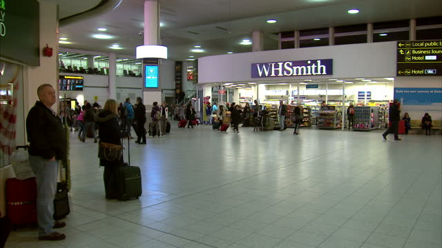 interior shots passengers walking about terminal hall at london gatwick airport on february 21, 2015 in west sussex, england. - 2015 video stock e b–roll