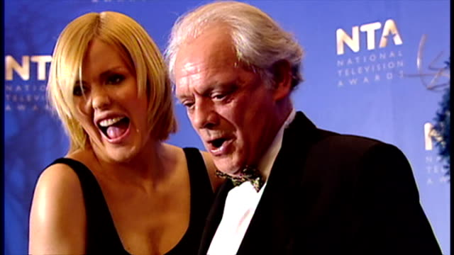 Interior shots Patsy Kensit poses on stage with David Jason at the National Television Awards Patsy Kensit David Jason on October 23 2001 in London...