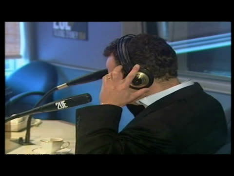 vidéos et rushes de interior shots paul burrell speak during radio interview general views burrell chatting to radio dj before wlk departure - book