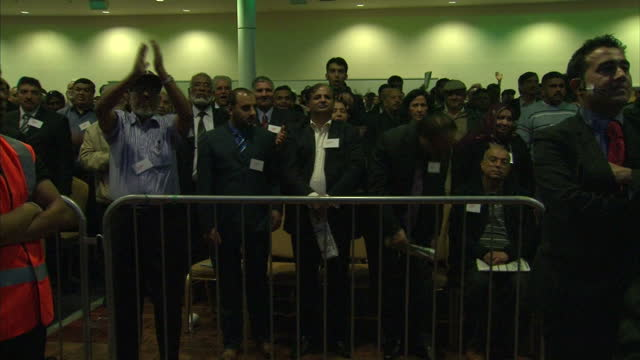 Interior shots Pervez Musharraf Pakistan's former President stood on stage taking in applause from members of the UK Pakistani community Former...