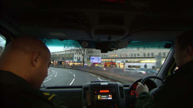interior shots point of view inside ambulance racing through streets on a call out on march 02, 2015 in bristol, england. - casualty stock videos & royalty-free footage