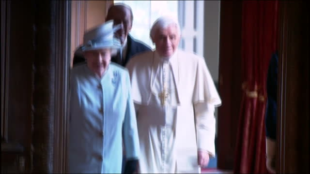 interior shots pope benedict xvi & queen elizabeth ii followed by prince philip walk into room in holyrood house & look through exchanged gifts.... - pope stock videos & royalty-free footage