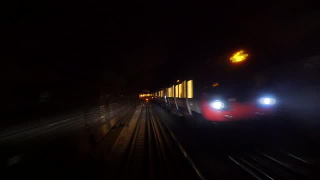 interior shots pov from drivers cab as london underground train drives along tracks and passes another underground train in tunnel. on may 14, 2015... - bahnreisender stock-videos und b-roll-filmmaterial