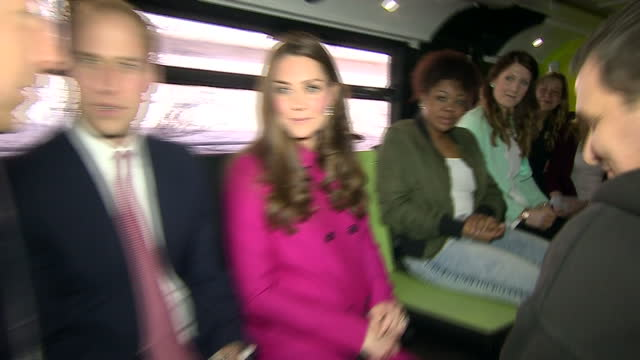 Interior shots pregnant Catherine Duchess of Cambridge and Prince William Duke of Cambridge talking to young people inside XLP Mobile recording...