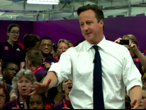 vídeos de stock, filmes e b-roll de interior shots prime minister david cameron addresses staff at the official uniform distribution centre for the olympics is heckled by an unseen... - david cameron político