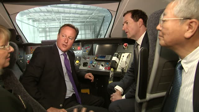 interior shots prime minister david cameron and chancellor george osborne and karen boswell inside cockpit of hitachi at300 train at the launch of... - cockpit stock videos & royalty-free footage