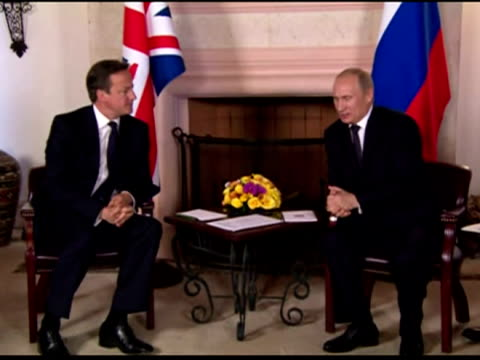 interior shots prime minister david cameron greets russian president vladimir putin both shakes hands for photo call before sitting down for talks... - photo call stock videos & royalty-free footage