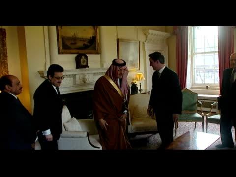 interior shots prime minister david cameron greets the saudi foreign minister prince saud al-faisal inside number 10 downing street along with... - prime minister bildbanksvideor och videomaterial från bakom kulisserna