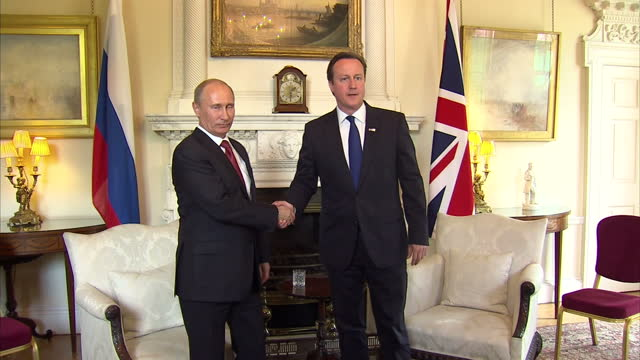 interior shots prime minister david cameron russian president vladimir putin walk into the white room inside number 10 pose for photo call before... - photo call stock videos & royalty-free footage