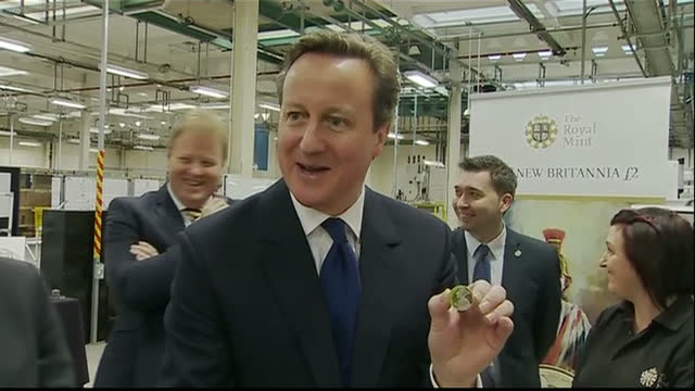 interior shots prime minister david cameron touring royal mint talking to employees watching minting of new coins on february 27 2015 in llantrisant... - royal mint stock videos & royalty-free footage