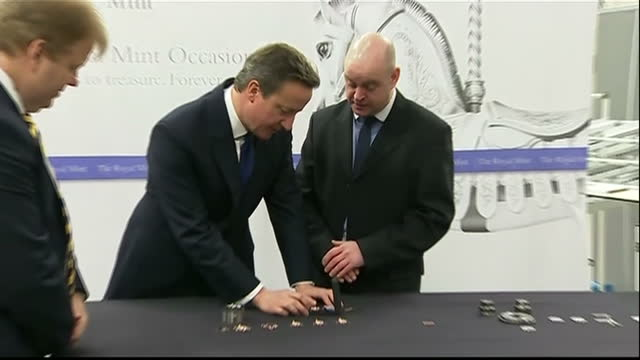 interior shots prime minister david cameron touring royal mint talking to employees looking at new two pound design with britannia image interior... - royal mint stock videos & royalty-free footage