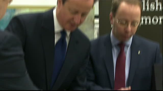 interior shots prime minister david cameron visiting royal mint llantrisant plant david cameron talking to officials at royal mint on february 27... - royal mint stock videos & royalty-free footage